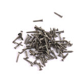 Pile of metal screws isolated Royalty Free Stock Image