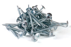 Pile of metal screws isolated on white background Stock Image