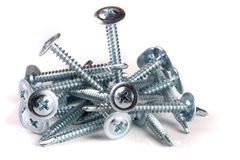 Pile of metal screws isolated on white background Royalty Free Stock Photo