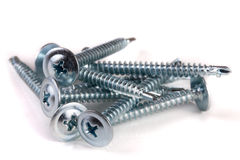 Pile of metal screws isolated on white background Stock Photos