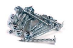 Pile of metal screws  on white background Royalty Free Stock Photos