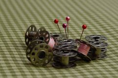 Sewing Bobbins, Thread, and Pins stock images