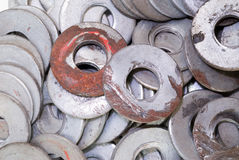Pile of Metal Washers. A pile of old metal washers for use in a machine shop Royalty Free Stock Photo
