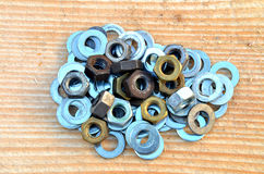 Pile of metallic washer and nuts. On wooden desk Royalty Free Stock Photography