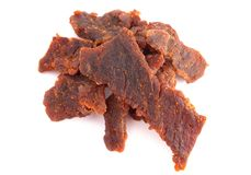 Pile of Mild Flavored Beef Jerky on a White Background. A Pile of Mild Flavored Beef Jerky on a White Background royalty free stock photos