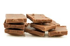 Pile of milk chocolate blocks Stock Photos