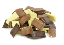 A pile of milk dark and white chocolate chunks Stock Image