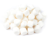 A pile of mini white puffy marshmallows on white background. Clo Stock Image