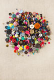 Pile of mixed buttons on hessian Royalty Free Stock Photos