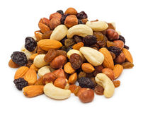Pile of mixed nuts. Mixed nuts and dry fruits pile isolated on white background Stock Photo