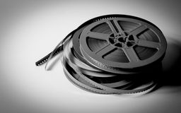 Pile of 8mm super8 movie reels in black and white. Pile of grey, blue, yellow and purple 8mm super8 movie reels on white background, vintage look and black and Stock Photography