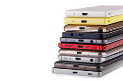 Pile of mobile phone. Heap of the different smartphones. Isolated on white background royalty free stock photography