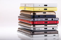 Pile of mobile phone. Heap of the different smartphones. Stock Image
