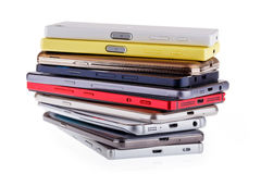 Pile of mobile phone. Heap of the different smartphones Stock Image