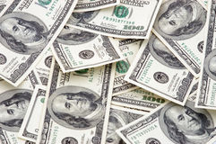 Pile of Money. Hundred dollar bills piled together Royalty Free Stock Photos