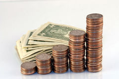 A pile of money. A pile of coins and cash Royalty Free Stock Photos