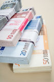Pile of money Stock Images