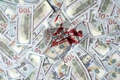Pile of money with bloody spot, top view. Dirty criminal profit. Dollar marked by murder. Bloody currency money covered. With traces of crime. Banknotes marked Royalty Free Stock Image