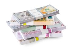 Pile of money - dollar and euro banknotes on white. Royalty Free Stock Images