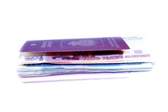 Pile of money invested in their passport Stock Photos