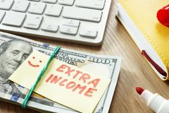 Pile of money with sign Extra income. The Pile of money with sign Extra income stock photos