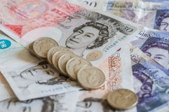 British money pounds sterling banknotes and coins Stock Photo