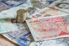 British economy at risk after Brexit. Uk votes to leave the EU. Image of English pound sterling GBP money. UK and European financial markets down after the Royalty Free Stock Photo