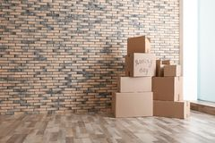 Pile of moving boxes. In empty room stock photo