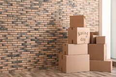 Pile of moving boxes. In empty room stock image