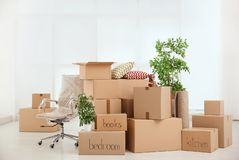 Pile of moving boxes. In empty room royalty free stock photos