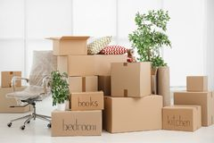 Pile of moving boxes. In empty room stock photography