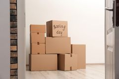 Pile of moving boxes. In empty room royalty free stock photography