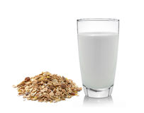 Pile of muesli and fresh milk in the glass on white bac Royalty Free Stock Photos