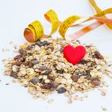 Pile of muesli, heart and measurement tape Stock Photography