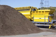 Compost. Pile of mulch at a green recycle plant ready to be fed into an industrial grinder to make compost Royalty Free Stock Photos