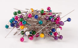 Pile of  multi-colored sewing pins on a white background Stock Image
