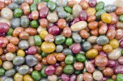 Multicolored glazed raisins background royalty free stock image