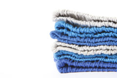 Pile of multicolored knitted clothes Royalty Free Stock Photos