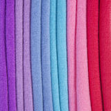 Pile of multicolored knitted clothes Royalty Free Stock Photo