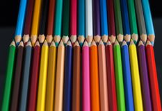 Multicolored wooden crayon 4. Pile of multicolored wooden crayon  on the black background with the reflection Stock Photos