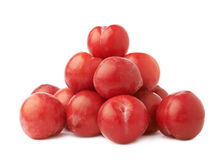 Pile of multiple red plums isolated Royalty Free Stock Photography