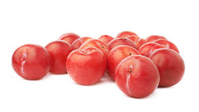 Pile of multiple red plums isolated Royalty Free Stock Image