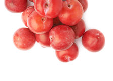 Pile of multiple red plums isolated Stock Photos