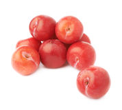 Pile of multiple red plums  Stock Images