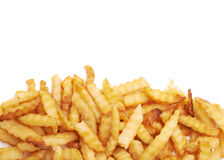 Pile of multiple wavy french fries isolated Stock Photography