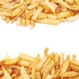 Pile of multiple wavy french fries isolated Royalty Free Stock Photography