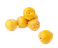 Pile of multiple yellow plums isolated Royalty Free Stock Photos