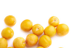 Pile of multiple yellow plums isolated Royalty Free Stock Image