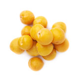 Pile of multiple yellow plums isolated Stock Photos