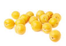 Pile of multiple yellow plums isolated Royalty Free Stock Images